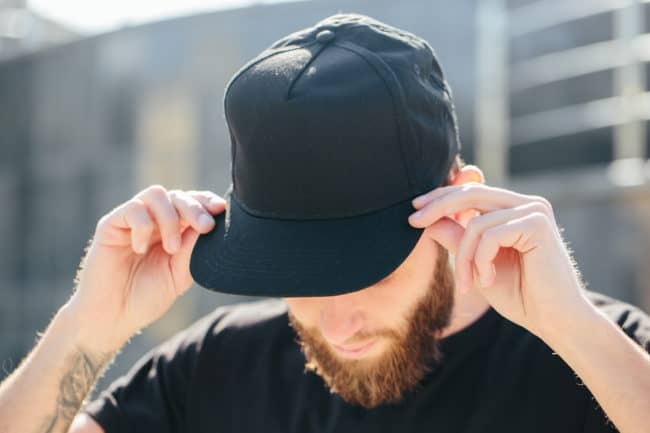 man with bad haircut with hat