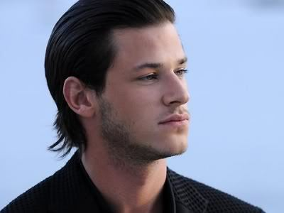 Gaspard Ulliel brushed back hairstyle