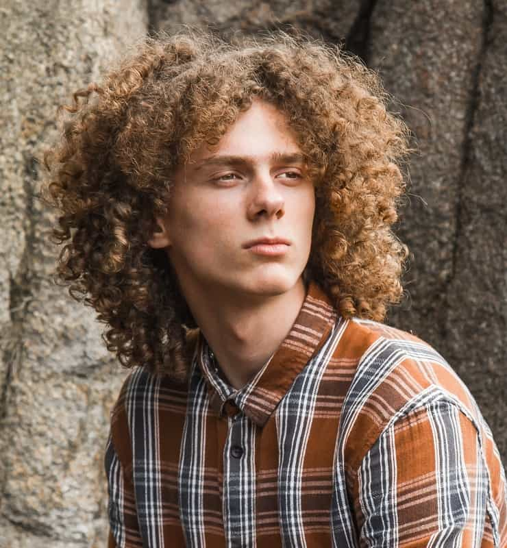 guy with curly mid parted hair