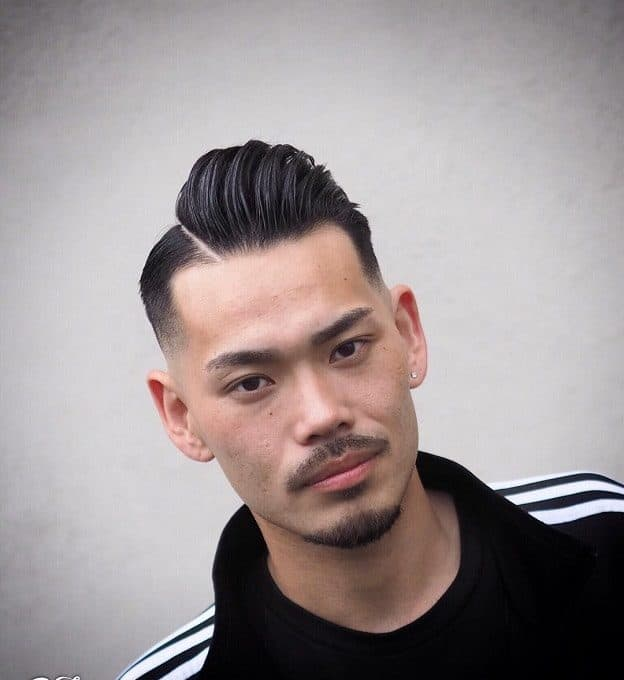 hard part haircut with pompadour