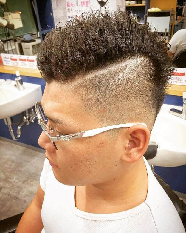 textured hard part haircut