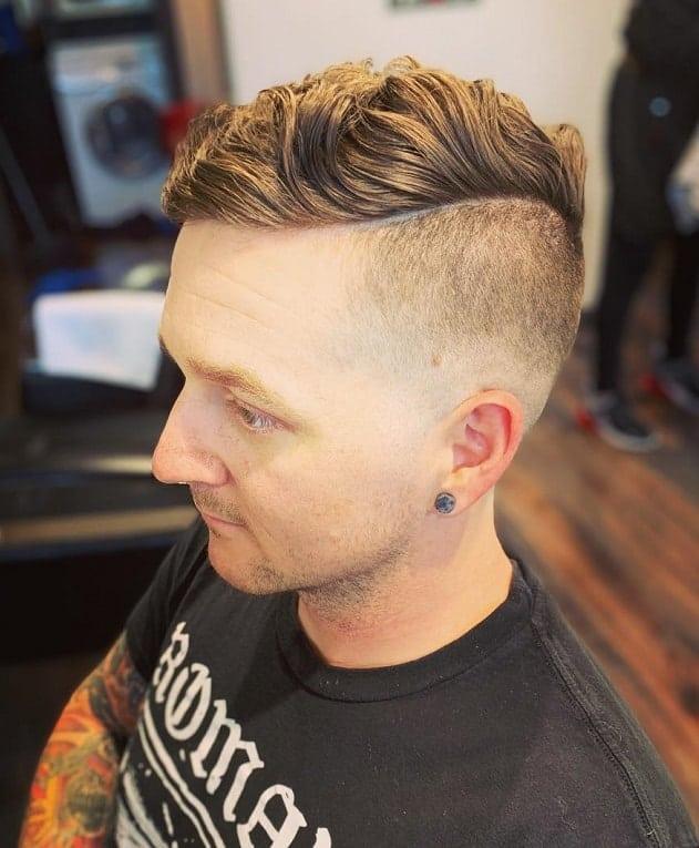 wavy hard part haircut
