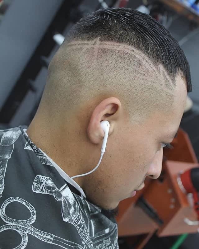 high bald fade with sleek short hair