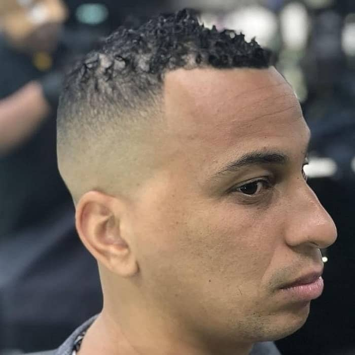 short curly hair with high bald fade