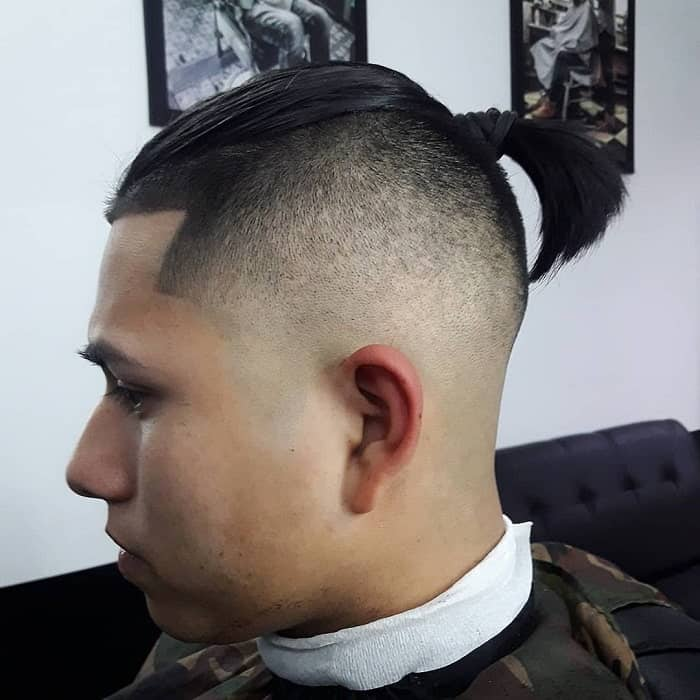 guys ponytail with high bald fade