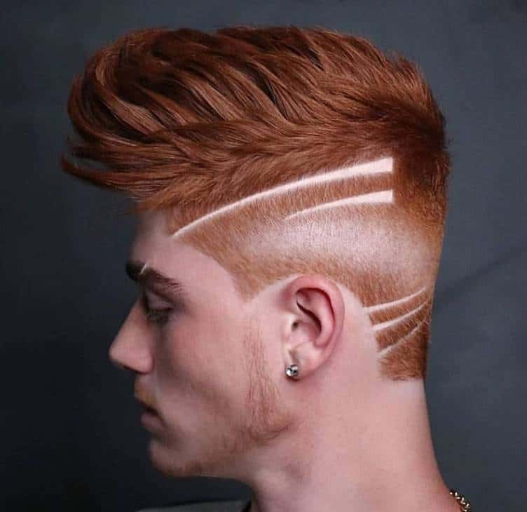 comb over with high fade and design