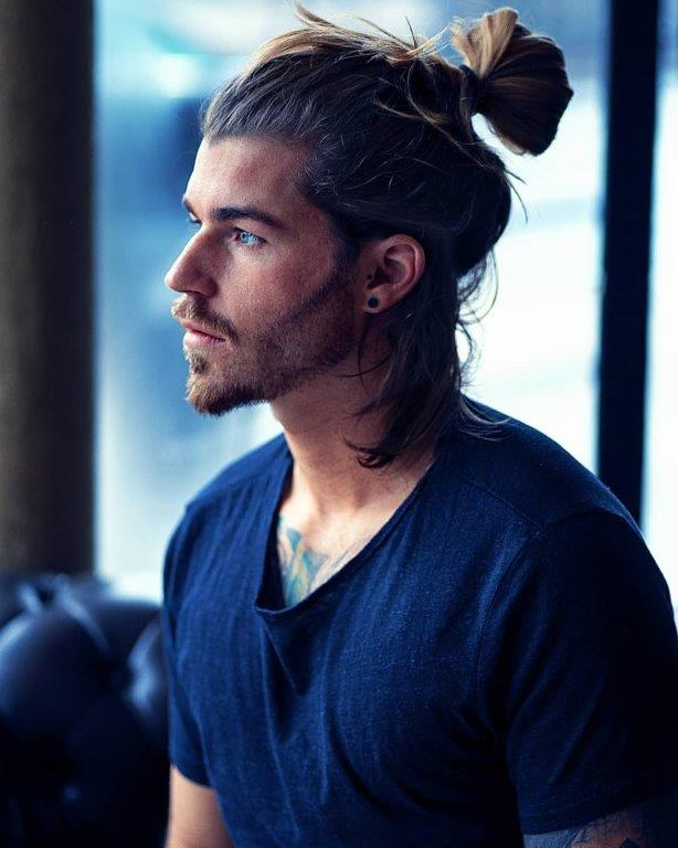 hipster guy with half up man bun