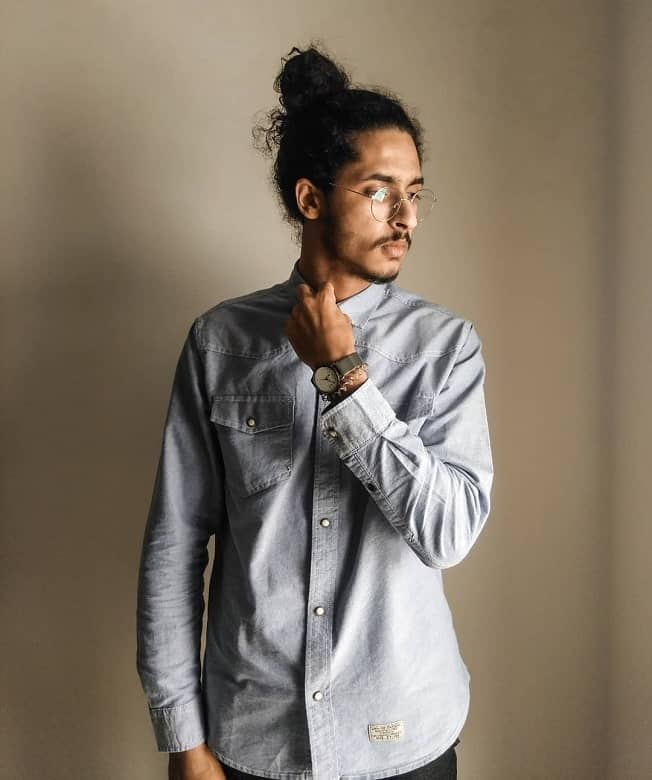 hipster guy with curly man bun