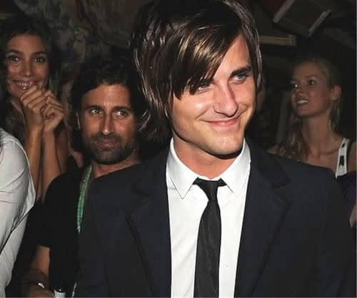 Photo of Jared Followill razored hairstyle with bangs.