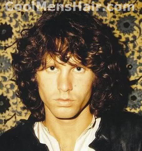 Photo of Jim Morrison thick wavy hairstyle for men.