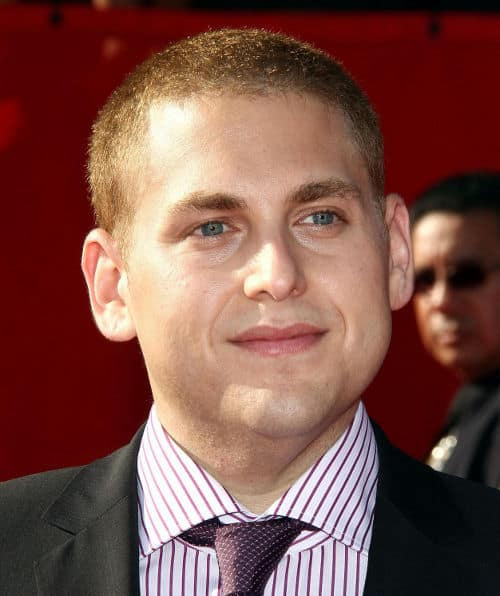 Photo of Jonah Hill buzz cut hairstyle.