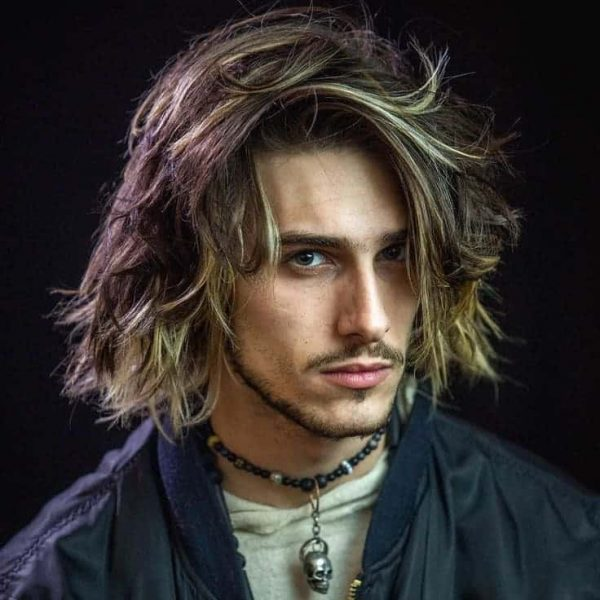 men layered hairstyle with highlights