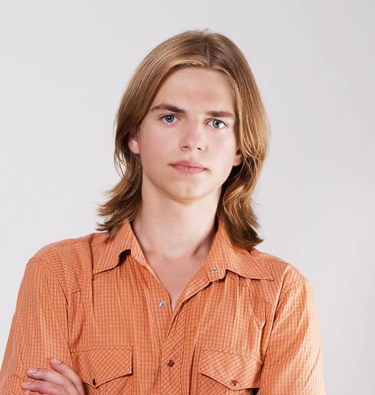 layered haircut with middle part for men