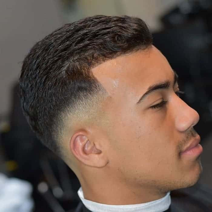 guy with low drop fade haircut