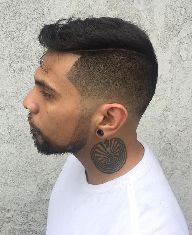 comb over blowout hairstyle with low fade