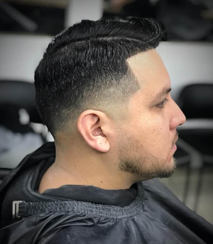 guy with low fade comb over