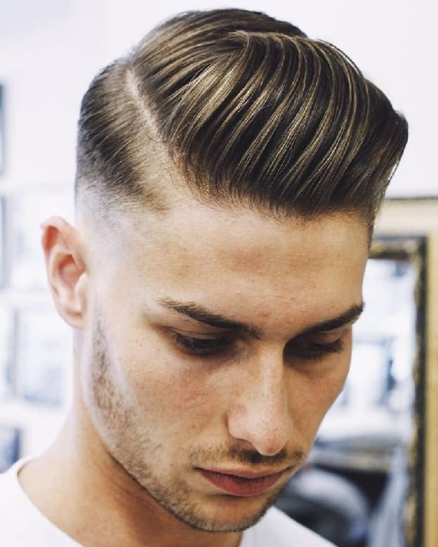 comb over quiff with low skin fade