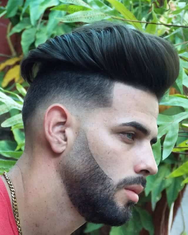 guy with long hair and low fade