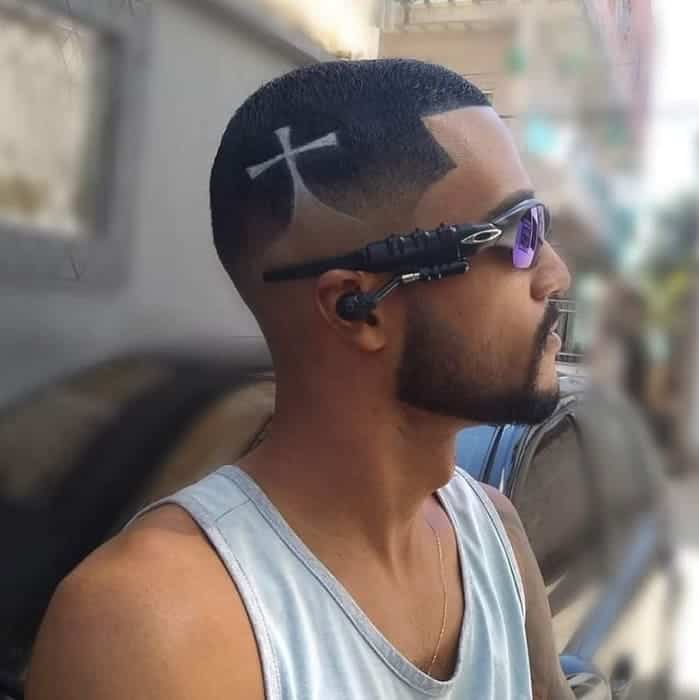 black men low fade haircut with design