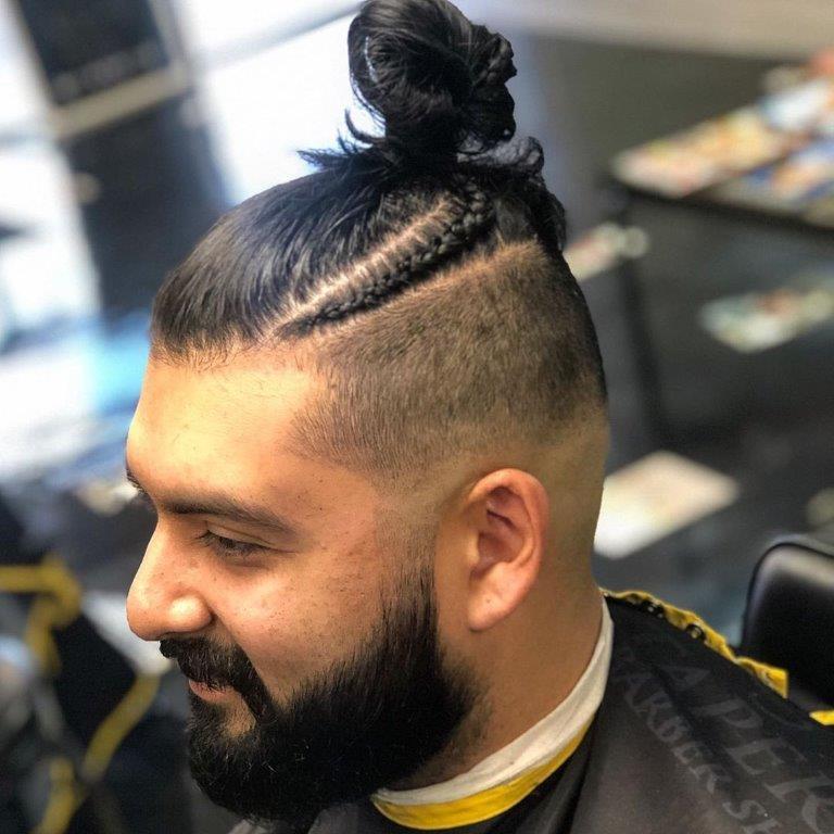 braided man bun with medium beard