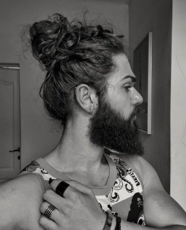 messy top bun with full beard