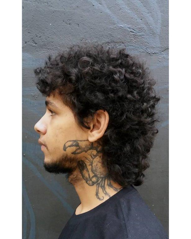 mexican guy with curly mullet hairstyle