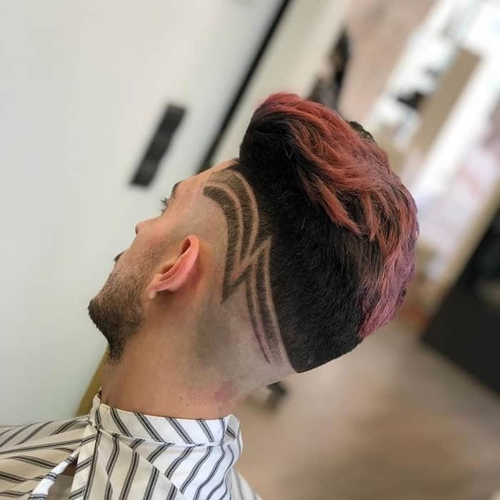 mid bald fade with messy pink hair