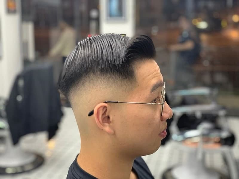 Asian guy with mid bald fade hairstyle