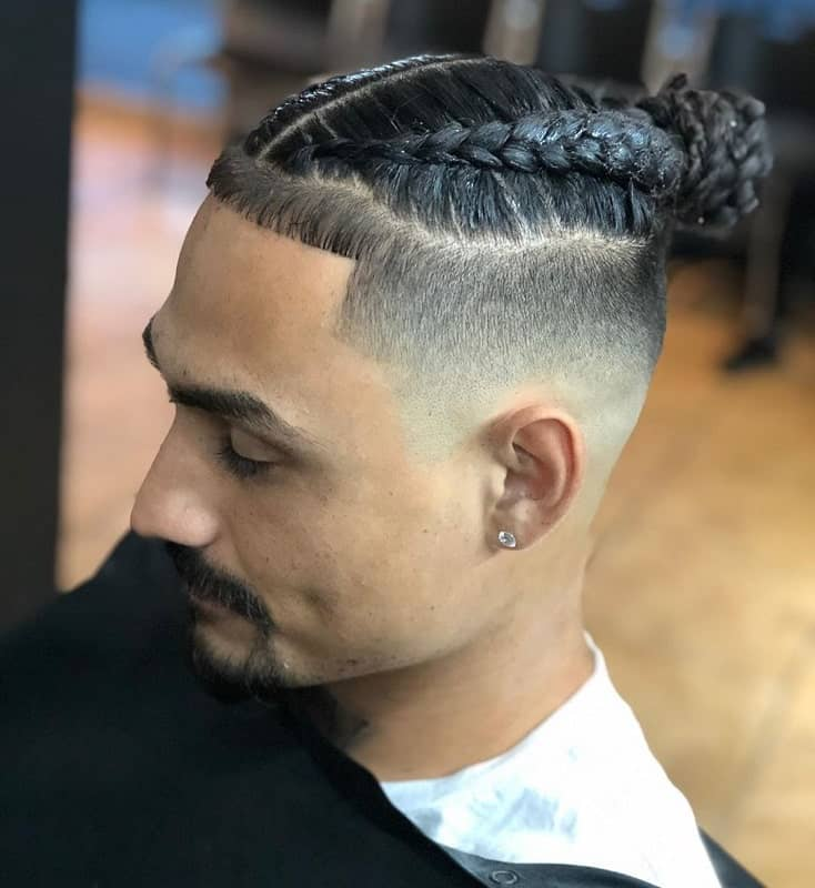 braided hairstyle with mid bald fade