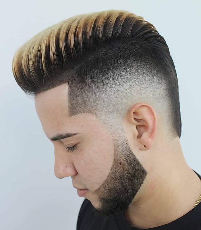 mid bald fade hairstyle with highlights