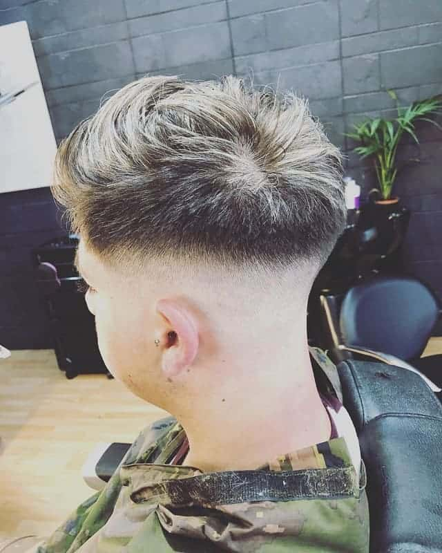 men's hairstyle with blonde tips and mid bald fade