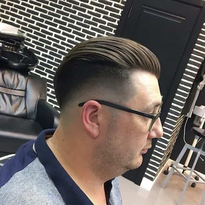 Slick Pompadour with Low Fade for Middle Aged Men