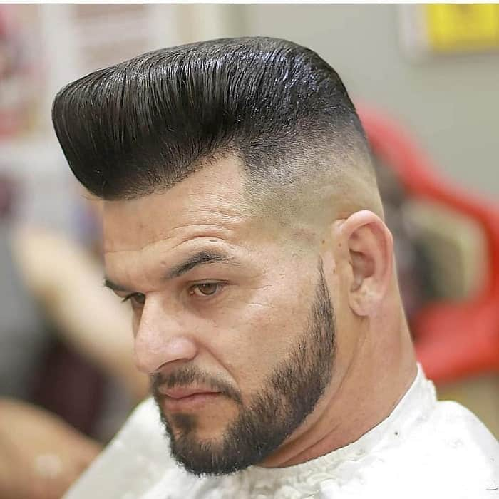 middle aged man with pompadour