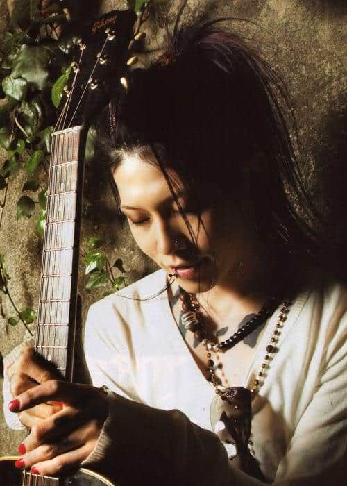 Photo of Miyavi ponytail hairstyle for guitarist.