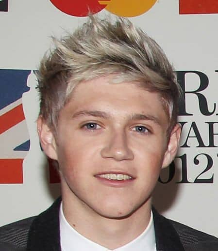 Photo of Niall Horan hairstyle with razored ends.