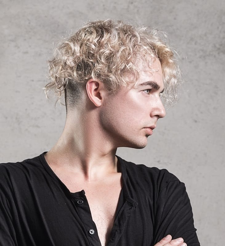 blonde guy with permed hair
