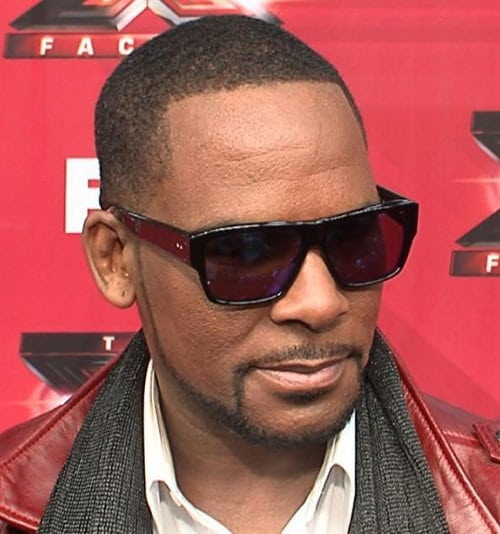 R. Kelly buzz haircut with rap industry standard beard.
