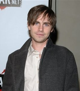 Photo of Rider Strong with layered bangs hair.