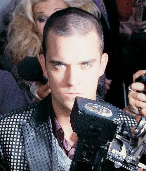 Photo of Robbie Williams buzz cut.