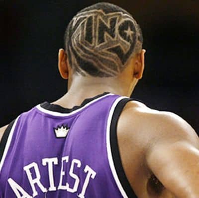 Photo of Ron Artest hair with King lettering.