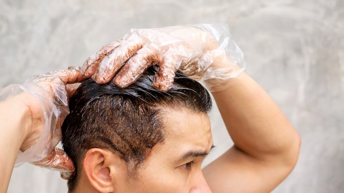 bad habits that damages men's hair