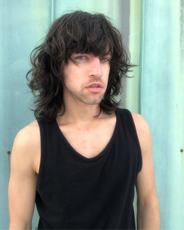 wavy long shaggy haircut for boys