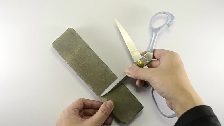sharpen hair cutting scissors using stone