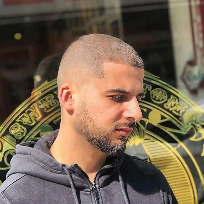 short buzz cut with bald fade