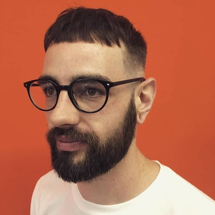 short choppy haircut with low fade
