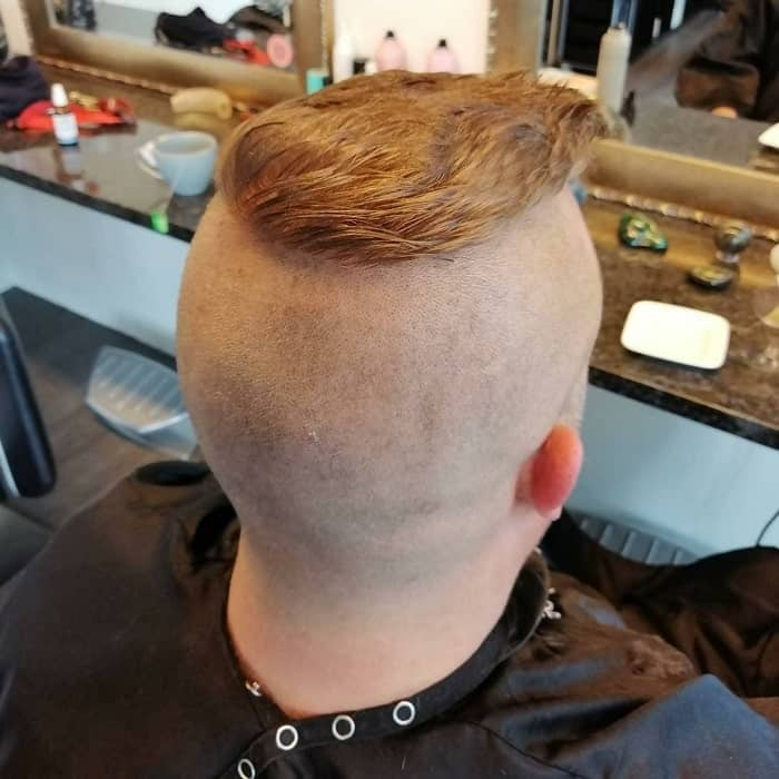 short faux hawk with shaved head