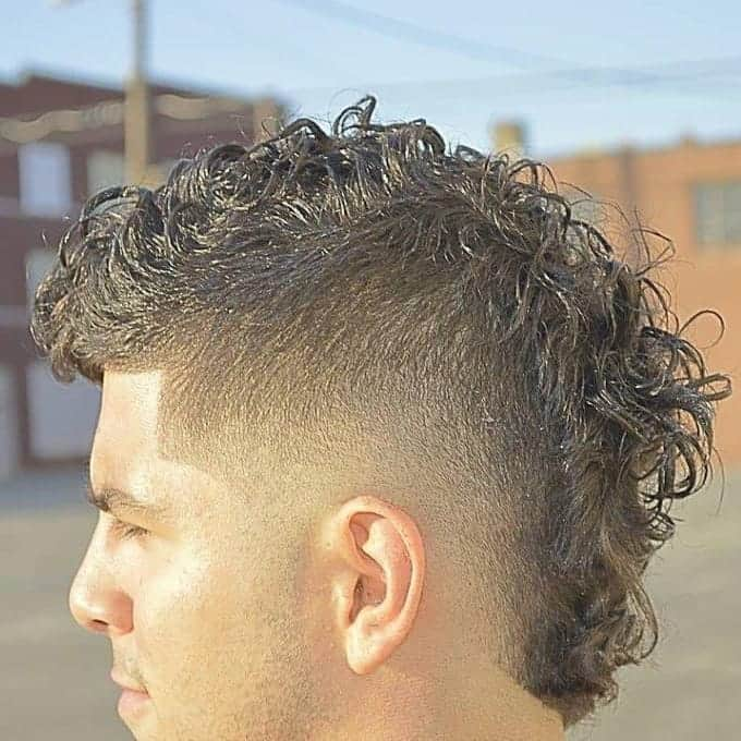 short and messy mohawk fade for men