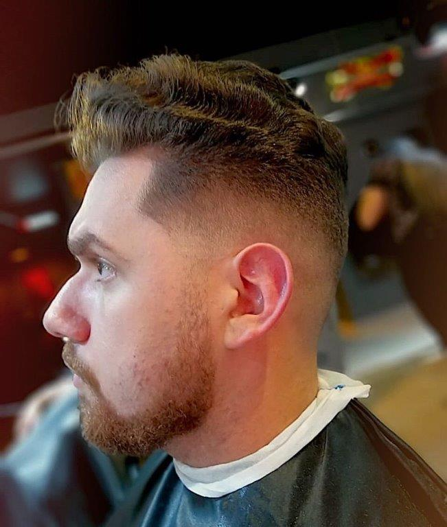 wavy short pompadour with mid fade
