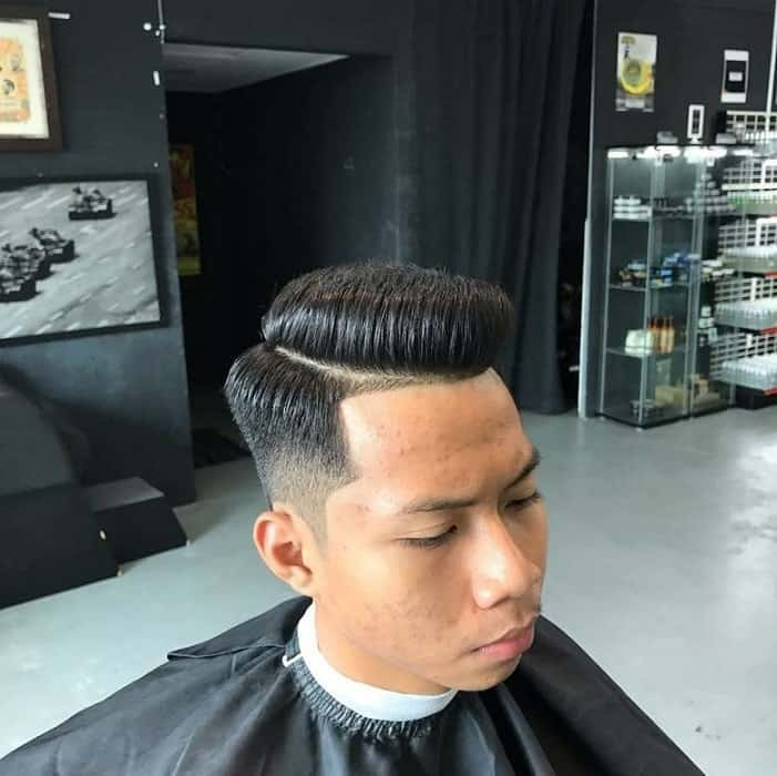 guy with side part pompadour undercut