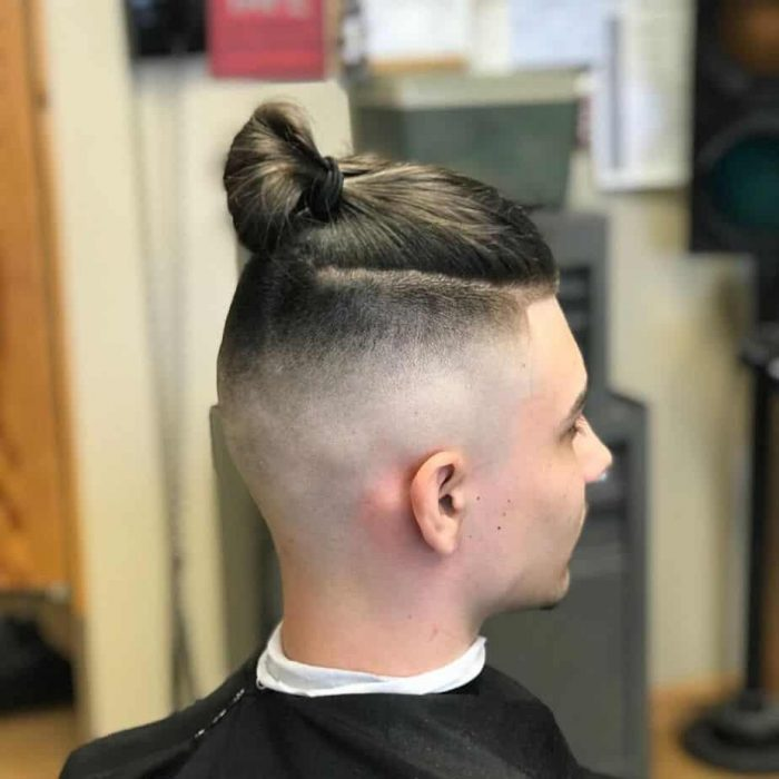skin fade comb over with top knot